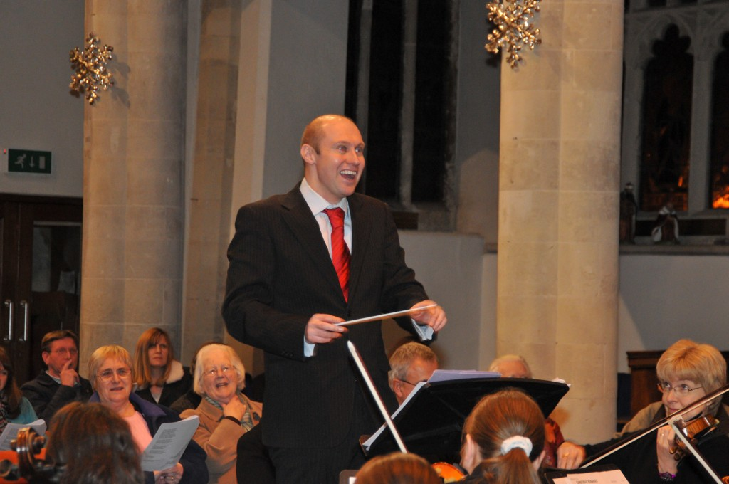 Neil Quigley having a go at conducting the Orchestra