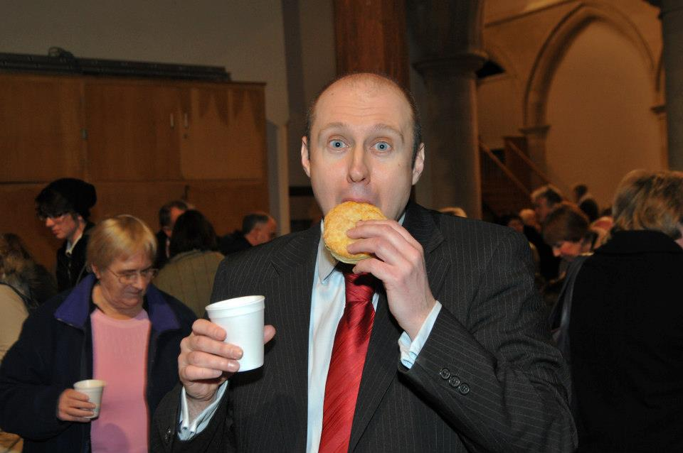 Neil enjoying a Mince Pie